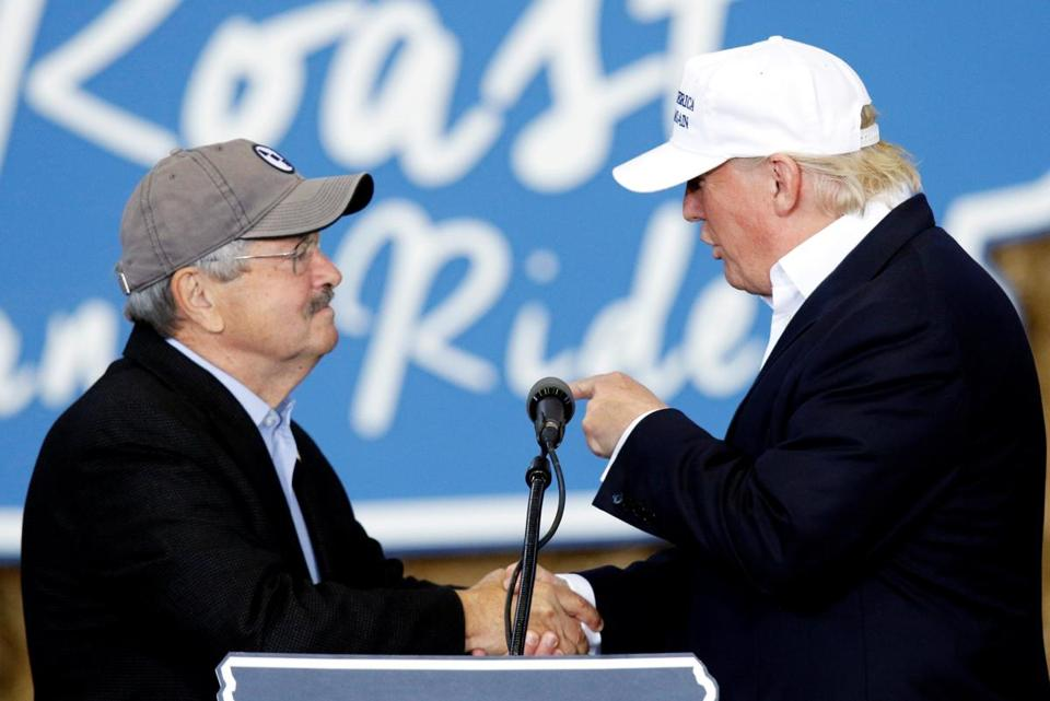 Republican presidential nominee Donald Trump (right) greeted Governor Terry Branstad of Iowa during an appearance Saturday in Des Moines.
