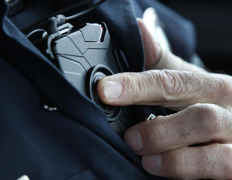 A police officer activated the recording mechanism on a body camera.