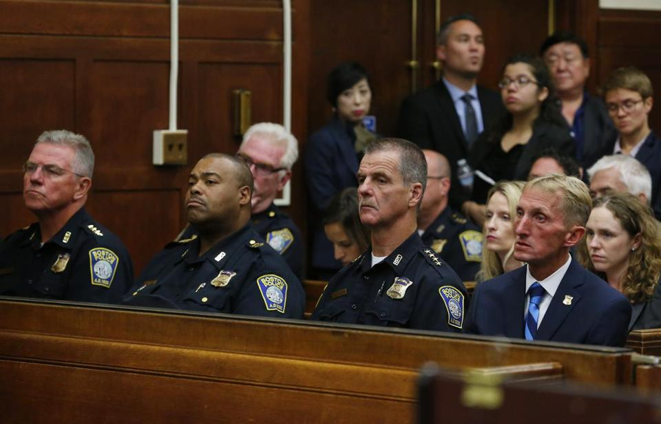Boston, MA - 9/6/2016 - Members of the Boston Police Department including Police Commissioner William Evans (R) and Superintendent-in-Chief William Gross (2nd from L) listen to the proceedings during the body camera hearing at Suffolk Superior Court in Boston, MA, September 6, 2016. (Jessica Rinaldi/Globe Staff) Topic: 07camerapic