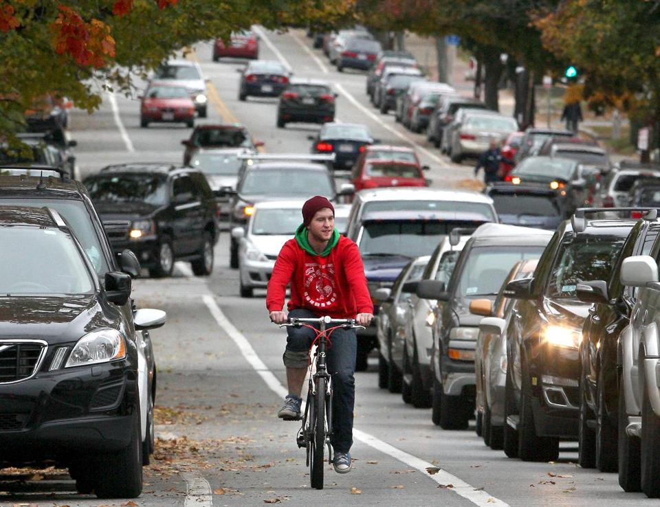 A cyclist makes his way down Route 114 in Salem.