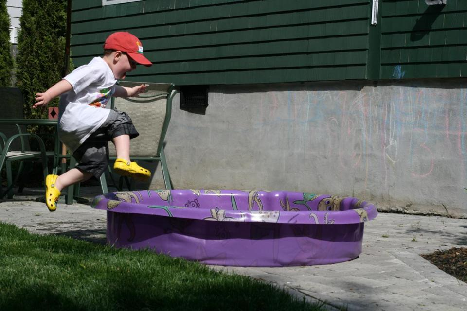FOR LACEY PROJECT ONLY. Lacey_online_Photo -Info from source: Will Lacey with wading Pool Taken on June 1, 2008. (Lacey family)