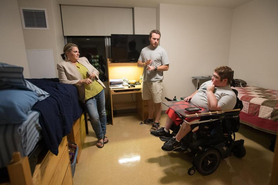 Christine McSherry spoke with her son, Jett, and his roommate Josh Dyer in their dorm room.