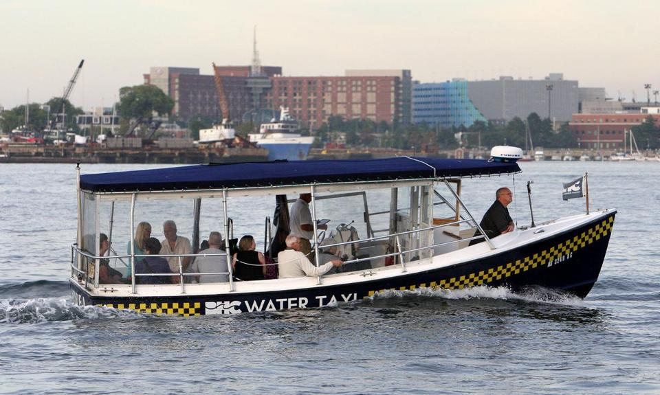 Boston, MA: 09-20-2016: A water taxi in Boston Harbor with the East Boston shore behind Sept. 20, 2016. (Photo was taken during a tour of Boston Harbor in Boston, Mass. looking at possible ferry dock locations and the future of water transportation in the harbor.) Photo/John Blanding, Boston Globe staff story/Shirley Leung, Business ( 23leung )