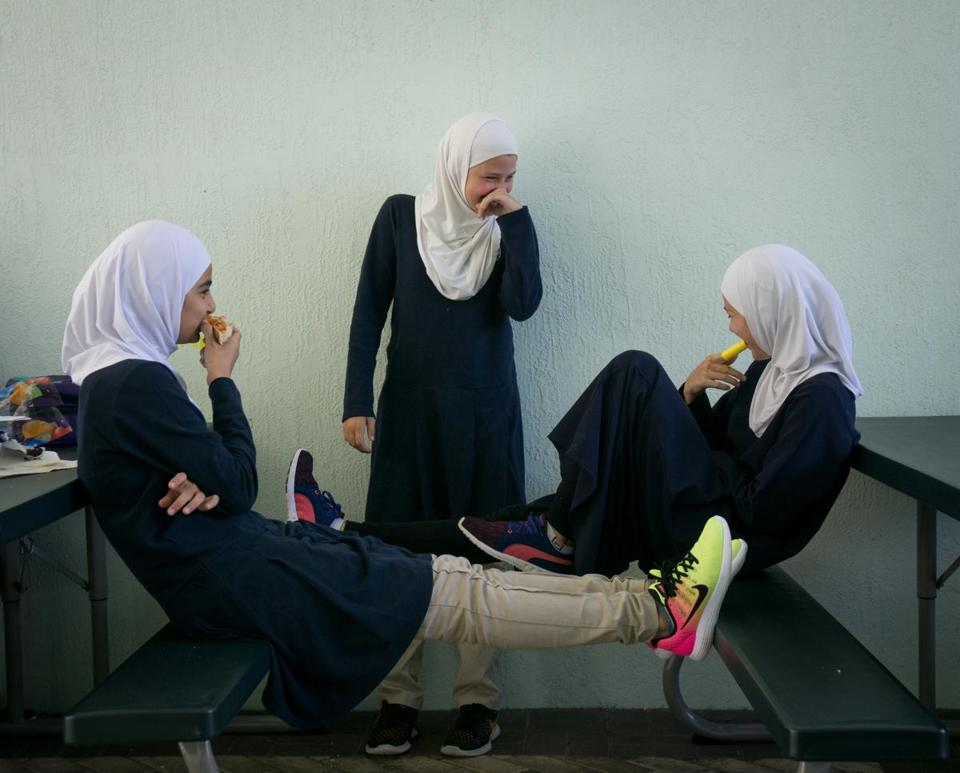 Mariam Harb, left, Ayah Elassadi, center, and Hanan Krijestorac, right, enjoyed a laugh during a lunch break at the Garden of Sahaba Academy, an Islamic school at the Islamic Center of Boca Raton.