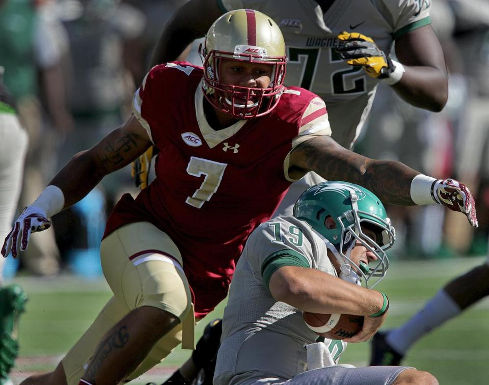 Chestnut Hill, MA - 9/24/2016 - (3rd quarter) Boston College Eagles defensive end Harold Landry (7) gets to Wagner Seahawks quarterback Alex Thomson (19) for a sack during the third quarter. Boston College football hosts Wagner at Alumni Stadium in Chestnut Hill. - (Barry Chin/Globe Staff), Section: Sports, Reporter: Gary M Washburn, Topic: 25BC-Wagner, LOID: 8.3.73211174.