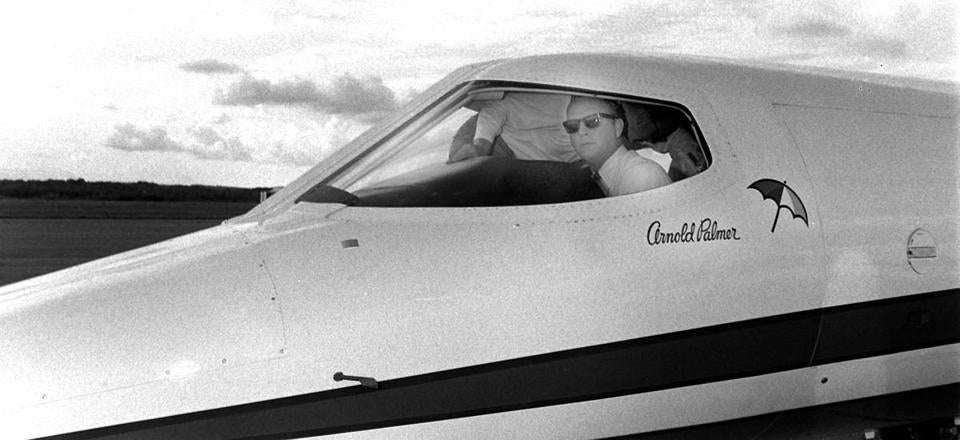 Palmer was in the cockpit of his plane after landing at the then-Worcester Airport in 1968.