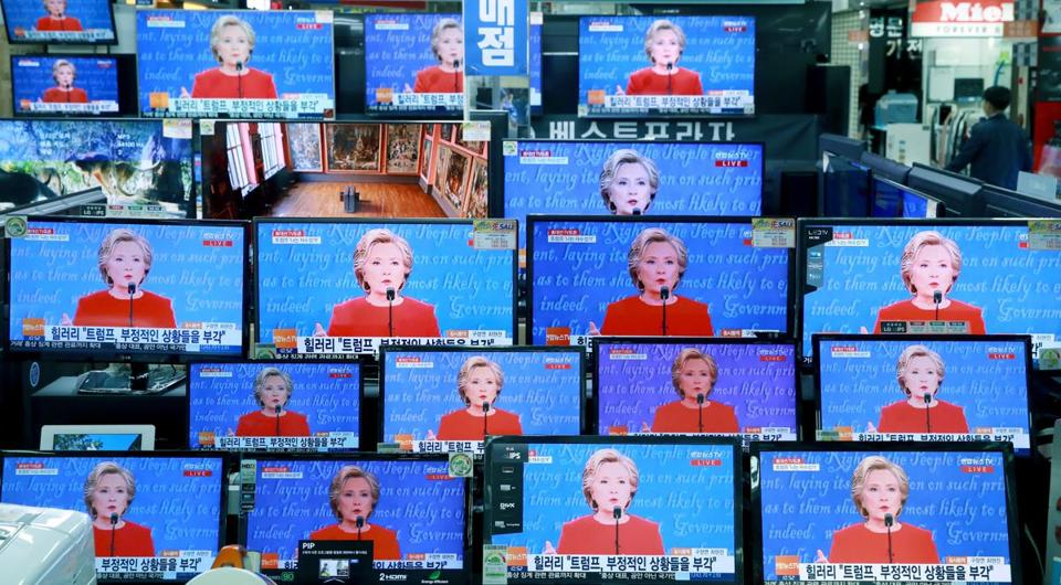 TV screens show the live broadcast of Democratic presidential nominee Hillary Clinton during the U.S. presidential debate with Republican presidential nominee Donald Trump, in Seoul, South Korea, Tuesday, Sept. 27, 2016. (Hong Hae-in/Yonhap via AP) KOREA OUT