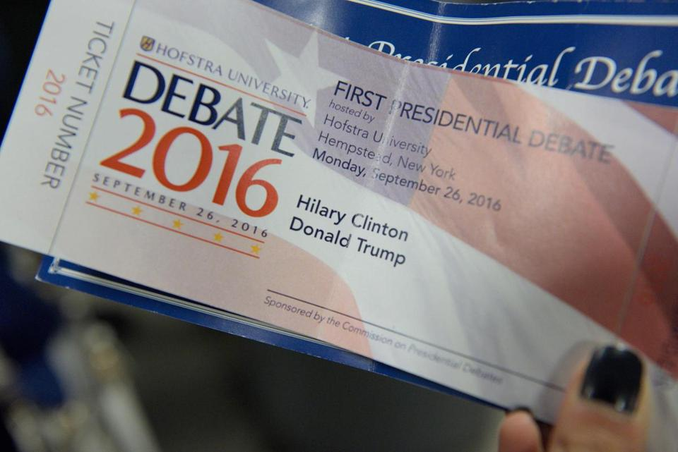 "A woman holds a Presidential debate ticket with the name ""Hilary"" misspelled during the first presidential debate at Hofstra University in Hempstead, New York on September 26, 2016. The first US presidential debate, between Democratic candidate Hillary Clinton and Republican Donald Trump, is one of the high points of the campaign, six weeks from the November 8 elections. / AFP PHOTO / Brendan SMIALOWSKIBRENDAN SMIALOWSKI/AFP/Getty Images"