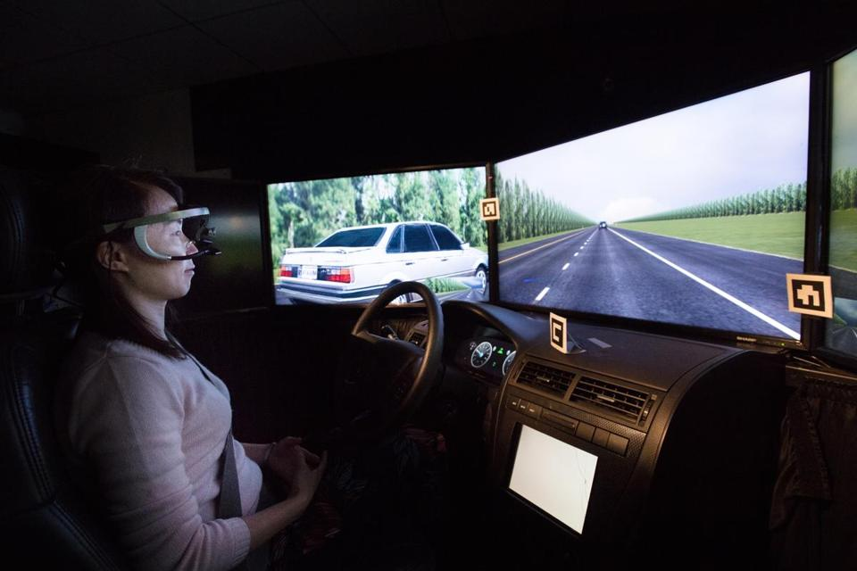 Yulan Liang, a research scientist for Liberty Mutual, demonstrated a self-driving automobile simulator in Hopkinton.