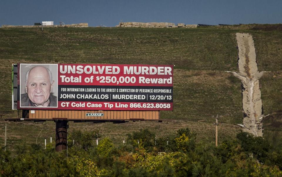 The billboard announcing a reward leading to the arrest of a suspect in John Chakalos' killing.