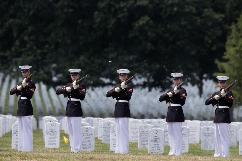 Marines fired three rifle volleys during a burial service at Arlington National Cemetery in August.