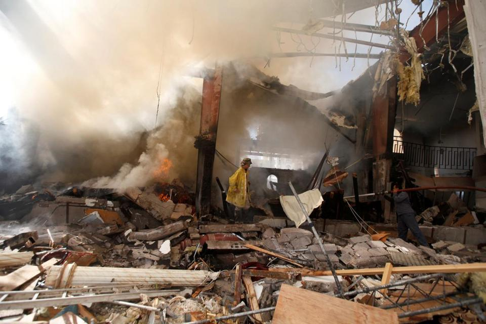 Firefighters worked Sunday at the community hall in Sana where a funeral was targeted by a Saudi-led coalition Saturday.