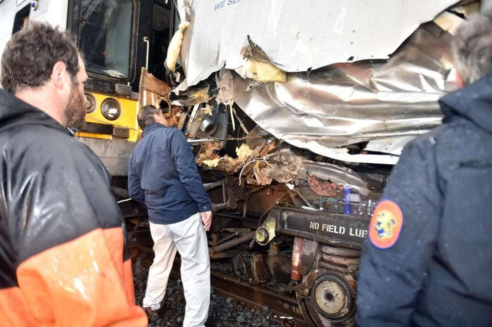 "In this October 9, 2016 handout photo provided by the office of New York Governor Andrew Cuomo, shows Governor Cuomo inspects damage to a Long Island Rail Road train that derailed and collided with a work train late October 8, along the mainline in New Hyde Park, New York. The LIRR train was heading eastbound on the mainline when the first three cars of a 12-car train derailed about one half mile east of the New Hyde Park Station. A New York commuter train derailed outside the city late Saturday, authorities said, without immediately confirming reports that dozens have minor injuries. ""The 9:22PM train from Penn due Huntington at 10:28PM has been canceled due to a train derailment near New Hyde Park,"" the Long Island Rail Road (LIRR) said on Twitter. According to the governor's office of the approximately 600 passengers on board at the time of the incident, 33 people sustained injuries, none of which were considered to be life-threatening. / AFP PHOTO / Office of Governor Andrew M. Cuomo / Kevin P. COUGHLIN / RESTRICTED TO EDITORIAL USE - MANDATORY CREDIT ""AFP PHOTO / Office of Governor Andrew M. Cuomo/ Kevin P. Coughlin"" - NO MARKETING - NO ADVERTISING CAMPAIGNS - DISTRIBUTED AS A SERVICE TO CLIENTS KEVIN P. COUGHLIN/AFP/Getty Images"