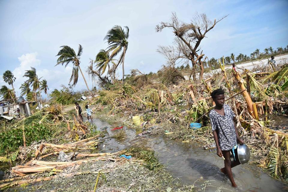 A girl walked past debris left by Hurricane Matthew in Sous Roche, Les Cayes, Haiti, on Sunday.