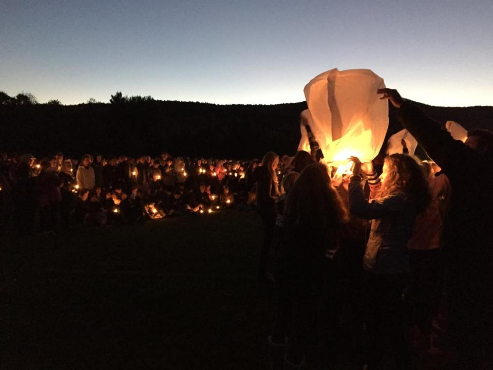 Students at Harwood Union High School in Duxbury, Vt. send lanterns into the air during a candle light vigil at the school Monday night to honor of their four classmates and a fifth friend who died Saturday night in a wrong-way crash on Interstate 89.