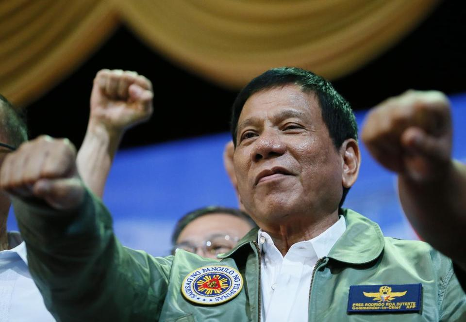 "Philippine President Rodrigo Duterte poses with a fist bump during his ""Talk with the Airmen"" on the anniversary of the 205th Presidential Airlift Wing Tuesday, Sept. 13, 2016 at the Philippine Air Force headquarters in suburban Pasay city, southeast of Manila, Philippines. On Monday, President Duterte, in his first public statement opposing the presence of American troops, said he wants U.S. forces out of his country's south and blamed the United States for inflaming Muslim insurgencies in the region. (AP Photo/Bullit Marquez)"