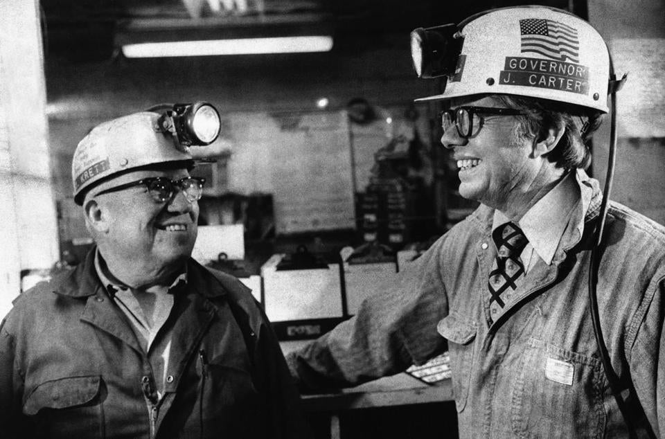 Democratic presidential candidate Jimmy Carter (right) spoke with a miner during a tour of a Pennsylvania coal mine in April 1976.