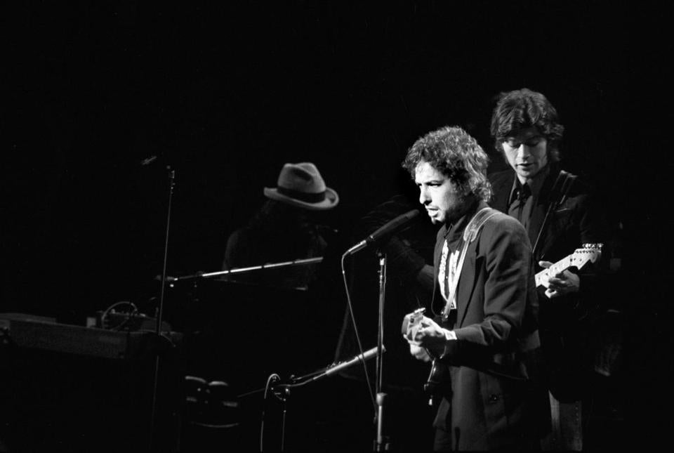 "Bob Dylan, left, and Robbie Robertson, guitarist for Dylan's backing band ""The Band,"" performed at Madison Square Garden in New York, Jan 30, 1974."