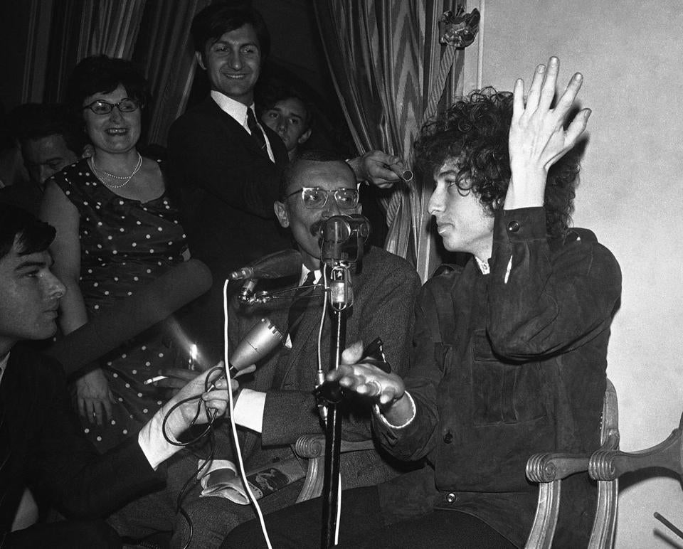 In this May 22, 1966, file photo, Bob Dylan gestured during a news conference in Paris, France.