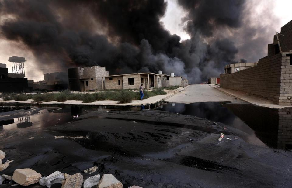 Smoke billowed from oil wells set ablaze by Islamic State militants fleeing from the Qayyarah region of Iraq in August.
