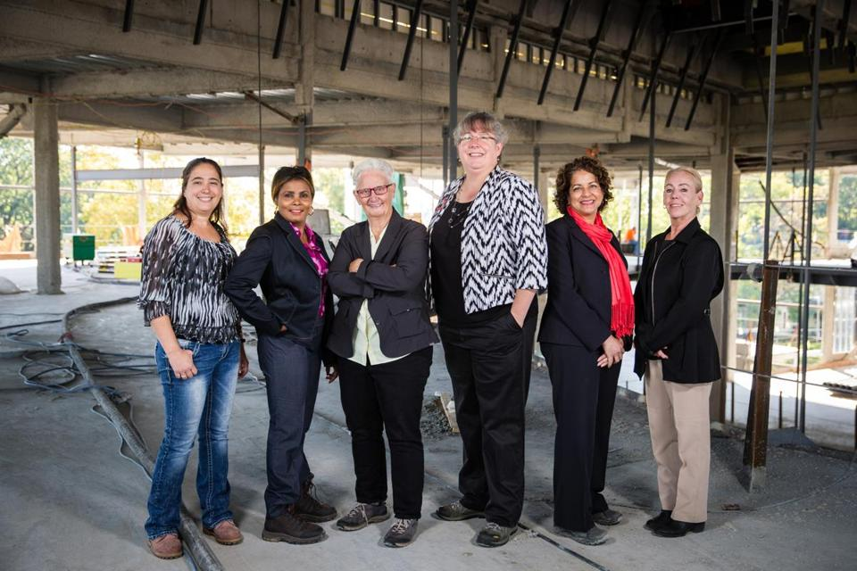 10/17/2016 ROXBURY, MA L-R Danielle Skilling (cq), Maggie Drouineaud (cq), Susan Moir (cq), Elizabeth Skidmore (cq), Jill Griffin (cq) and Linda Shaughnessy (cq) pose for a photo at a job site on Kearsarge Ave in Roxbury. (Aram Boghosian for The Boston Globe)