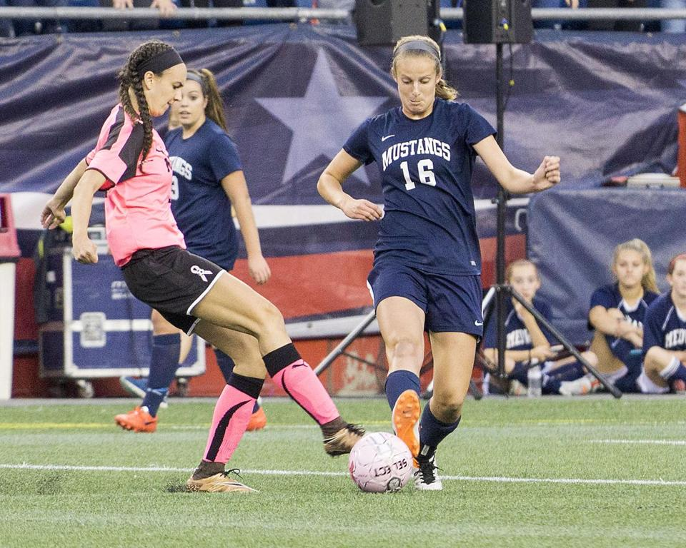 8.3.354904572_Regional_23wesoccer(2) Medway High girl's soccer captain Shannon Aviza (16) controls the ball as she gets past Midfield's Maggie Hurley (23) during the girl's high school soccer game at Gillette Stadium in Foxborough, Mass., Monday, Oct. 17, 2016. (Robert E. Klein for the Boston Globe)