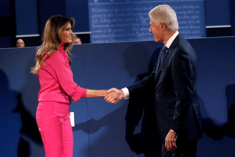 Former U.S. President Bill Clinton and Melania Trump shake hands before Republican U.S. presidential nominee Donald Trump and Democratic U.S. presidential nominee Hillary Clinton begin their presidential town hall debate at Washington University in St. Louis, Missouri, U.S., October 9, 2016. REUTERS/Mike Segar