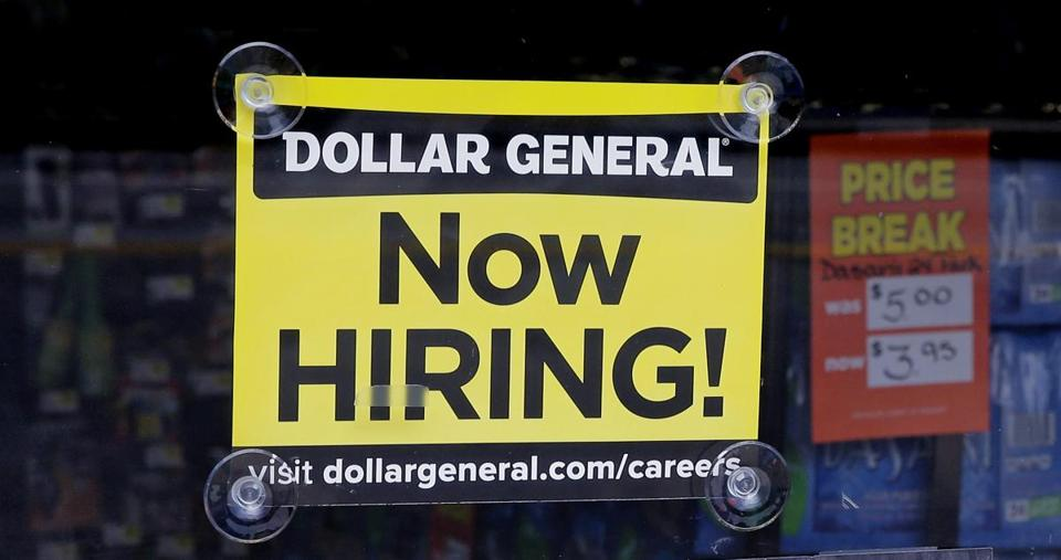 "FILE - In this Wednesday, May 18, 2016, file photo, a ""Now Hiring"" sign hangs in the window of a Dollar General store in Methuen, Mass. On Wednesday, Oct. 12, 2016, the Labor Department reports on job openings and labor turnover for August. (AP Photo/Charles Krupa, File)"