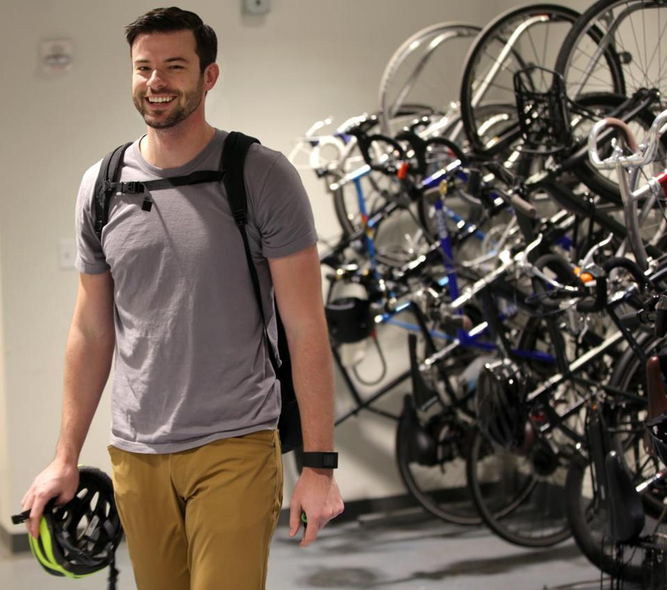 Cambridge Ma 10-19-2016 Kayak Employee Stephen Mueller (cq) arrives at work in Cambridge after a short commute. He is inside bike storage area. He is photographed for TPTW Boston Globe Magazine Edition. Boston Globe Staff/Photographer Jonathan Wiggs
