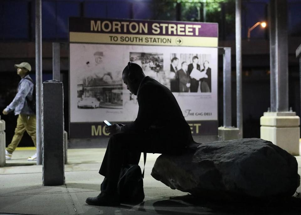 Stanley Innocent sat on a rock waiting for a train at Morton Street.