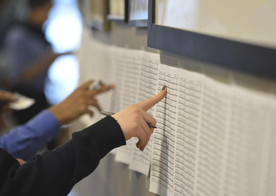 A City on a Hill Charter School student volunteer checked names of future students drawn from a list of hopefuls on lottery day in 2014.