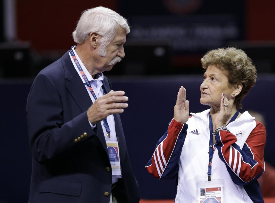 FILE - In this June 29, 2012, file photo, Bela Karolyi, left, and his wife Martha Karolyi talk on the arena floor before the start of the preliminary round of the women's Olympic gymnastics trials in San Jose, Calif. The latest lawsuit filed Thursday, Oct. 27, 2016, accusing Dr. Larry Nassar, a former USA Gymnastics doctor, of sexually abusing a longtime member of the U.S. women's national team is the first to name renowned husband-and-wife coaches Bela and Martha Karolyi, alleging they turned a blind eye to molestations. The Karolyis did not return messages seeking comment. (AP Photo/Gregory Bull, File)