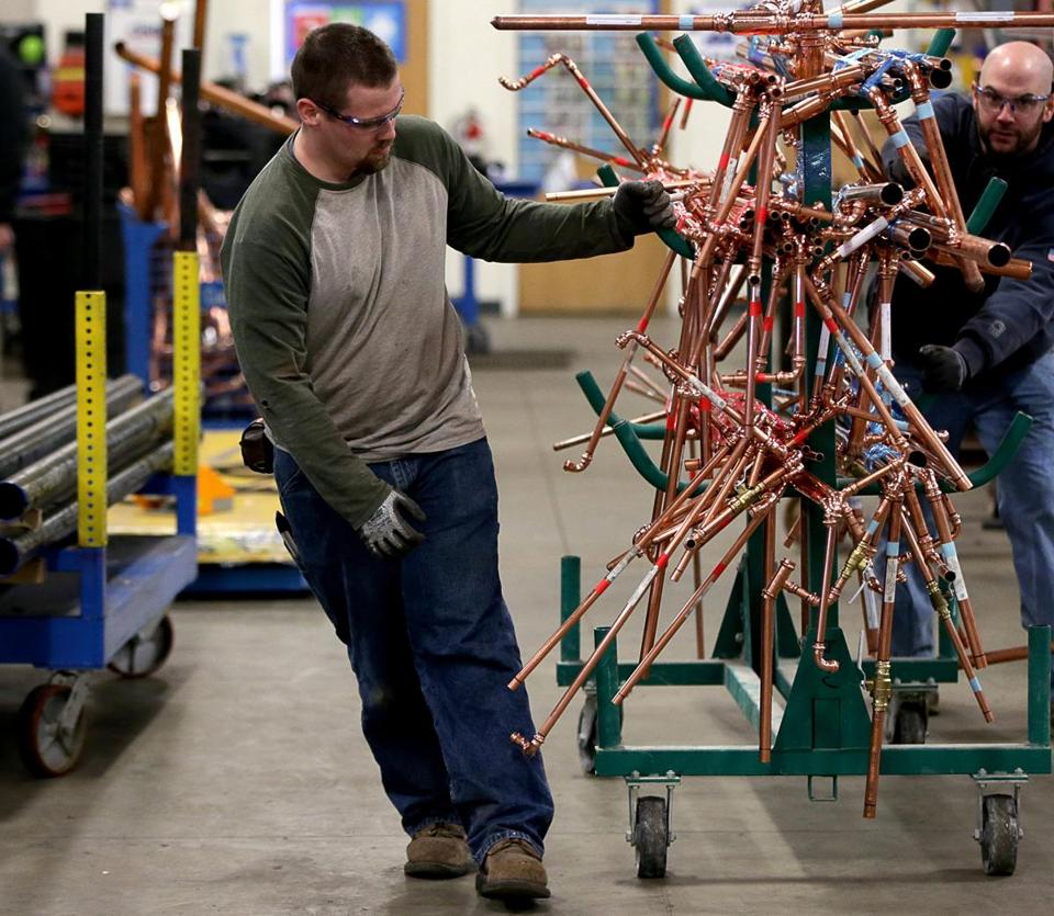 Wilmington Ma 10-26-2016 2016 Brian Janiac (cq) left in the plumbing shop at the Cannistraro fabrication facility in Wilmington. Boston Globe Staff/Photographer Jonathan Wiggs