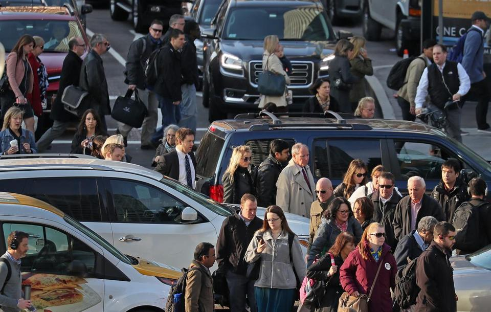 BOSTON, MA - 11/02/2016: Vehicles block the intersection during the THE MORNING RUSH HOUR in Boston at 9am crossing Atlantic Avenue and Summer Street from South Station in Boston making pedestrians meander through the vehicles. (David L Ryan/Globe Staff Photo) SECTION: METRO TOPIC stand alone photo