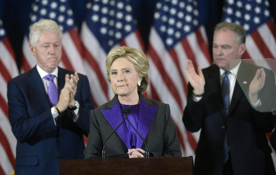 Hillary Clinton delivering her concession speech alongside her husband, Bill, and running mate, Tim Kaine, in November.