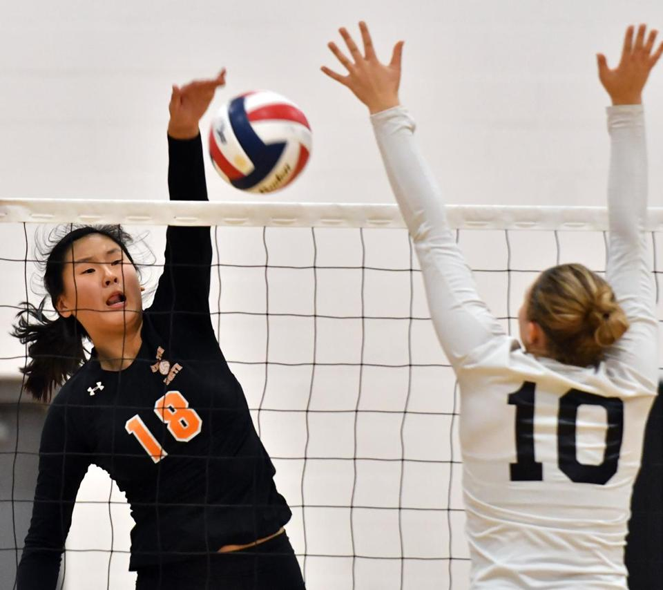 Ashley Wang (left) in action vs. North Quincy.