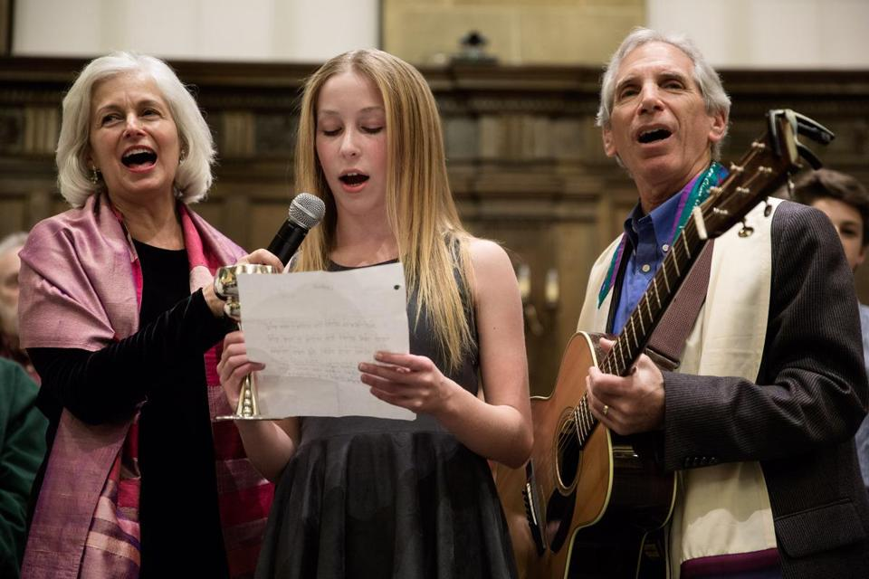 Rabbi Elaine Zecher, Olivia Gordon, 13, and Cantor Roy Einhorn sang at Temple Israel of Boston.