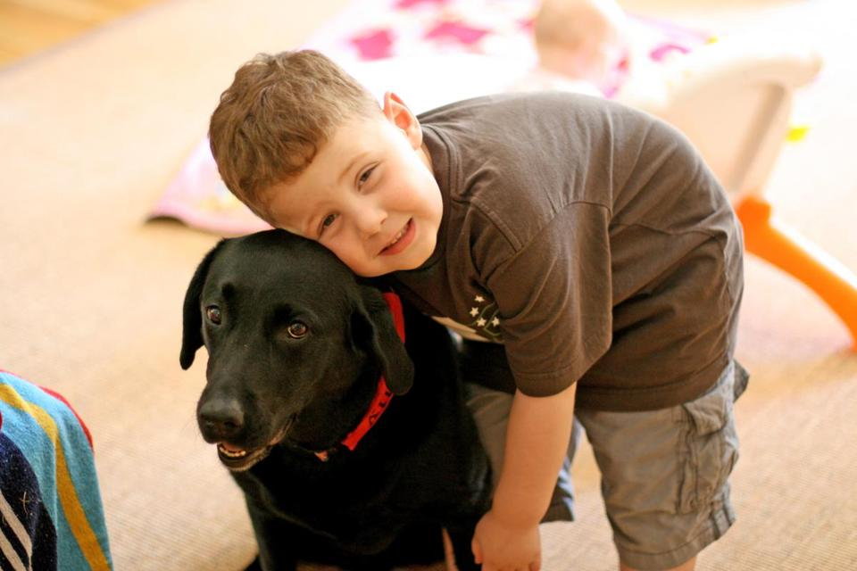 chp5will5 ---- Will Lacey with dog. Taken on July 11, 2008. (Lacey family)