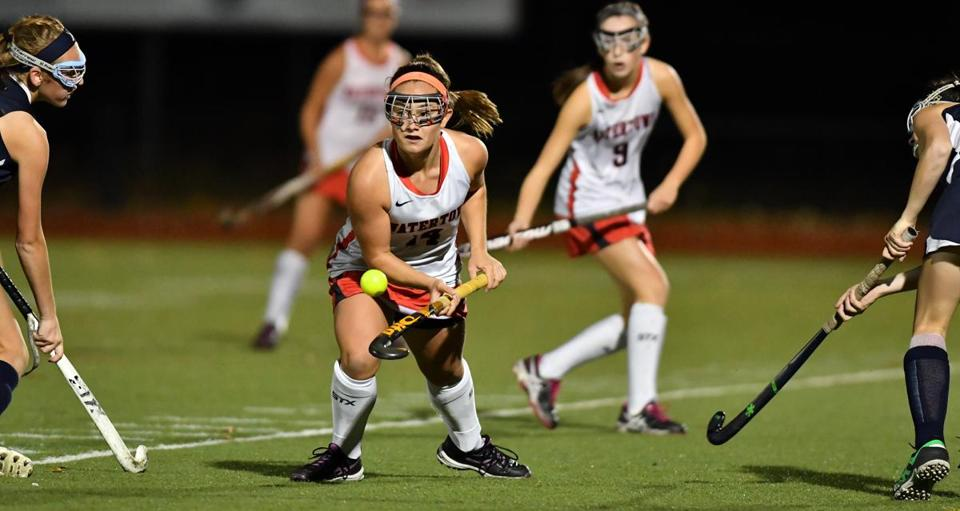Kourtney Kennedy of Watertown between Foxborough defenders during the Division 2 MIAA field hockey semifinals in Reading. Josh Reynolds for The Boston Globe (Sports, holmes)
