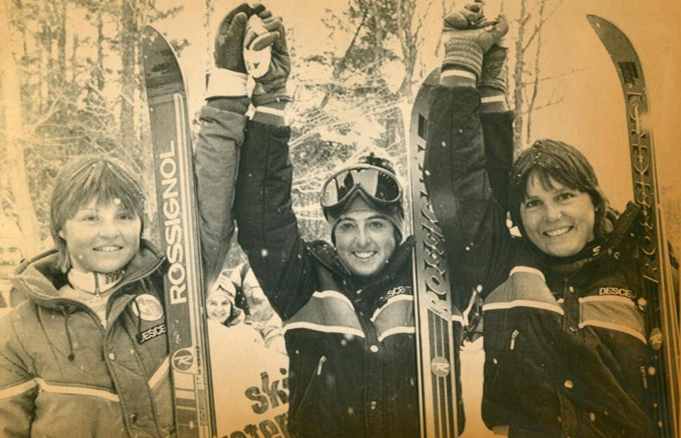 March 11 1984 / AP photo / WATERVILLE, VALLEY, NH / HAPPY WINNERS / Second place winner Erika Hess (left) and third place winner Cristin Cooper of the USA (right) and winner of the World Cup women's giant slalom Tamara McKinney (center) rejoice after Sunday's race. McKinney won both the slalom and giant slalom at Waterville. worldcup