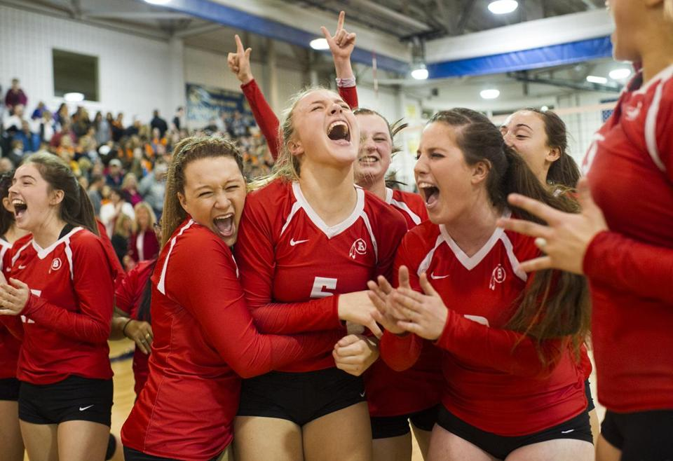 Barnstable's Girls Volleyball team celebrates following their win against Newton North in the MIAA Division 1 Girls Volleyball Championship at Shrewsbury High School on Saturday, November 19, 2016. Photo by Jackie Ricciardi for the Boston Globe