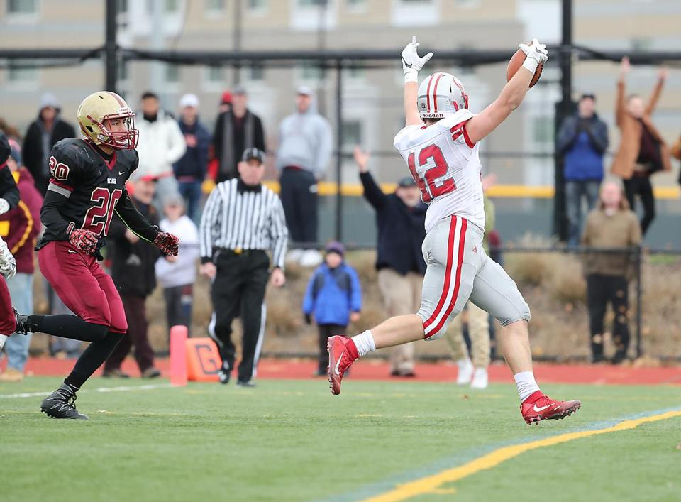 Boston MA 11/24/16 Catholic Memorial Jack McGowan scoring the game winning touchdown run beating Boston College High Nate Stewart during fourth quarter action of their Thanksgiving Day football game at Boston College High. (Photo by Matthew J. Lee/Globe staff) topic: 25bchigh reporter: