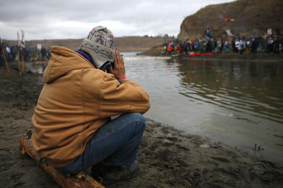A protester prayed at Standing Rock during the ongoing dispute over the building of the Dakota Access Pipeline.