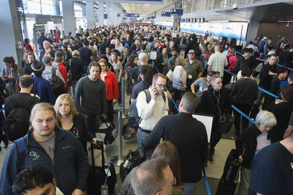 CHICAGO, IL - MAY 16: Passengers at O'Hare International Airport wait in line to be screened at a Transportation Security Administration (TSA) checkpoint on May 16, 2016 in Chicago, Illinois. Waiting times at the checkpoints today have been reported to be as long 2 hours. The long lines have been blamed for flight delays and a large number of passengers missing flights completely. (Photo by Scott Olson/Getty Images) 1211magazine