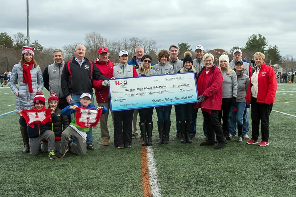 04sobrfhingham - Members of the Hingham Sports Partnership were recognized for their fundraising efforts during halftime of the Thanksgiving football game. (The Hingham Sports Partnership)