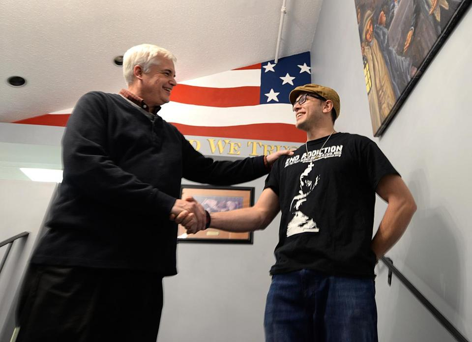 "Plymouth 11/30/2016 : New Testament Church Pastor Paul Jehle (cq), shakes hands with Justin Todd 27, a recovering addict. As part of Project Outreach, the New testament Church of Cedarville hosted a ""drop-in center'. The program brings together police departments, health care providers, and nonprofits in an effort to help tackle the opiod crisis. Photo by Debee Tlumacki for the Boston Globe (south)"