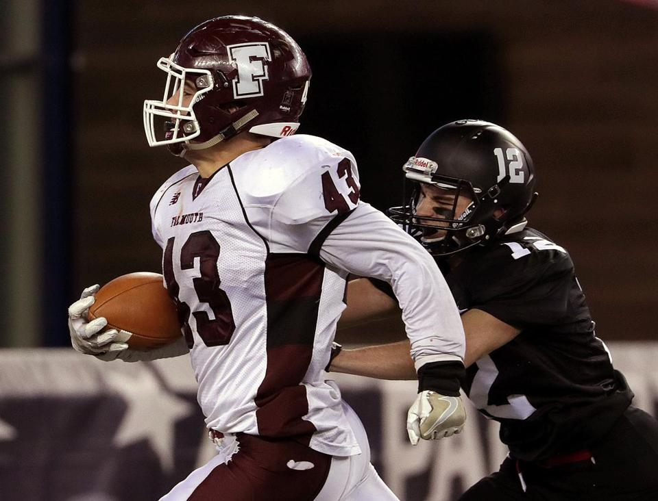 Falmouth's Gates Kelliher (43) eluded Marblehead's Justin Faia (12) to finish off one of his three touchdowns.