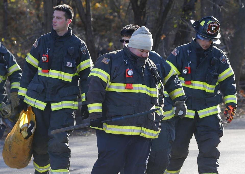 Braintree, MA -- 12/15/2016 - Firefighters return from the scene where one worker was rescued and one worker was killed at a water tower. (Jessica Rinaldi/Globe Staff) Topic: 16braintreepic Reporter: Andy Rosen