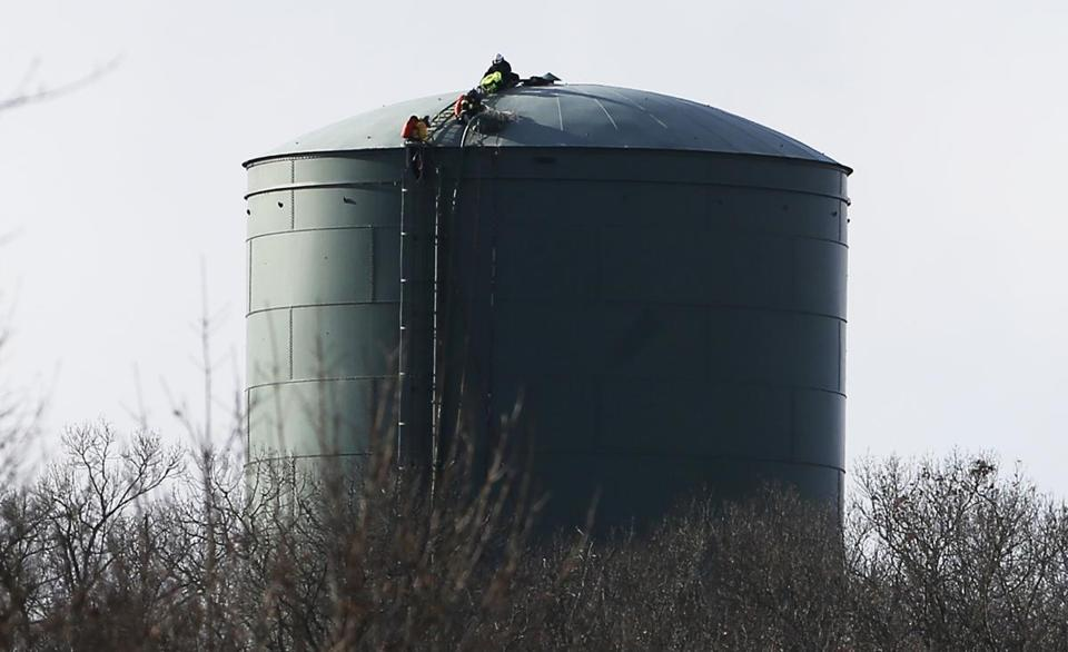 Braintree, MA -- 12/15/2016 - Tactical crews respond at the scene where one worker was rescued and one worker was killed at a water tower. (Jessica Rinaldi/Globe Staff) Topic: 16braintreepic Reporter: Andy Rosen