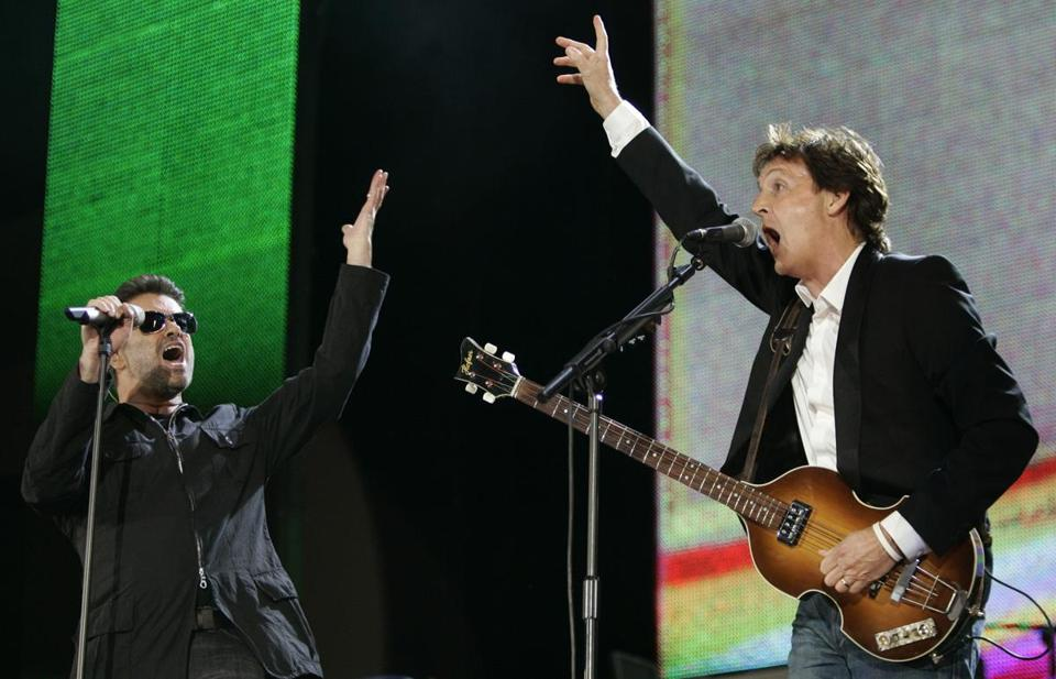 In July 2005, George Michael, left, and Paul McCartney, right, performed during the Live 8 concert in Hyde Park, London.